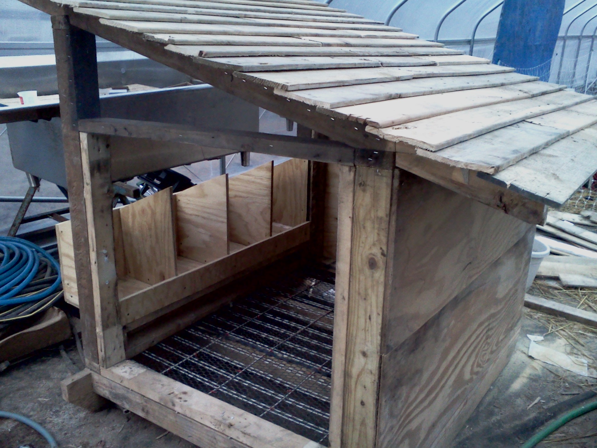 Coop with roof, nesting boxes, and partial walls